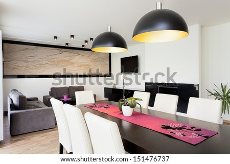 Urban apartment - Modern living room connected with dining room - stock photo