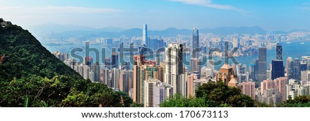 Urban architecture in Hong Kong in the day viewed from mountain top - stock photo