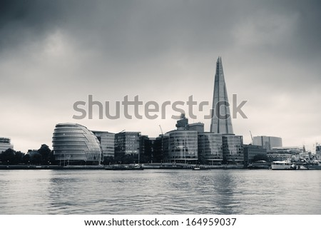 Urban architecture over Thames River in London in black and white. - stock photo
