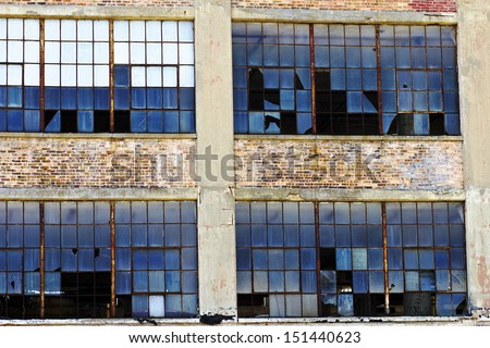 Urban Automotive Blight - Abandoned Automotive Factory - Worn, Broken and Forgotten I - stock photo