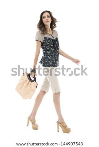 Urban beautiful young woman with modern a handbag walking in studio - stock photo