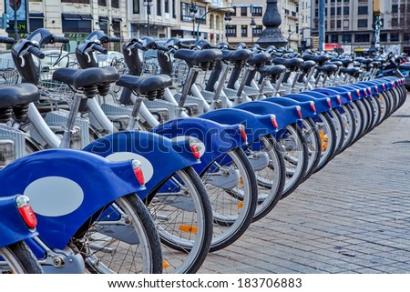 Urban bicycles on sharing station in Valencia, Spain. - stock photo