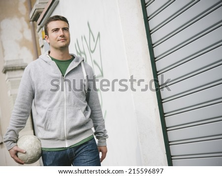 urban boy street soccer player - stock photo