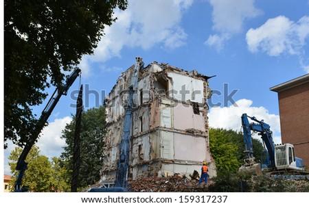 Urban building demolition - stock photo