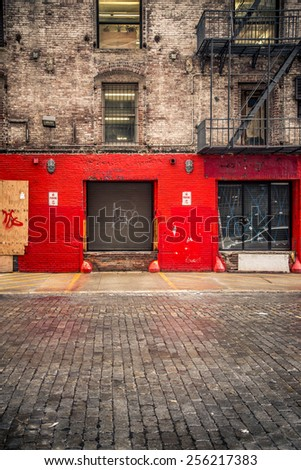 Urban building with loading bay and cobblestone street - stock photo