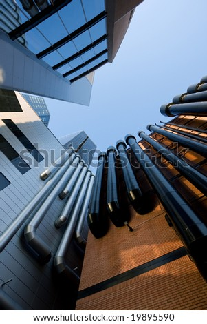 Urban buildings with tubes vertical - stock photo