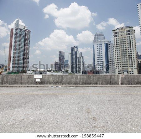 Urban  Carpark On city background. - stock photo