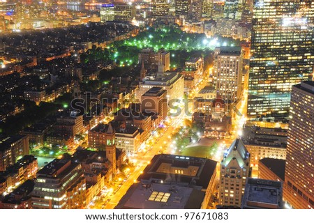 Urban city night scene. Boston aerial view with skyscrapers at night with city skyline illuminated. - stock photo