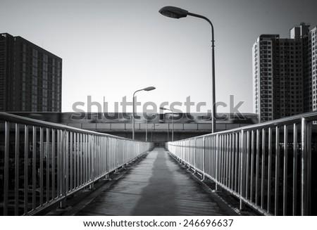 Urban construction the pedestrian overpass - stock photo