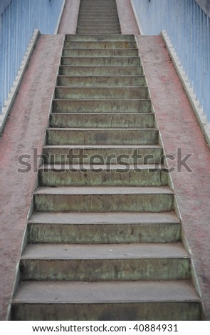 Urban footbridge staircase with symmetrical composition - stock photo