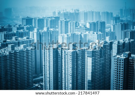 urban forest new real estate buildings , haze and excessive development  - stock photo