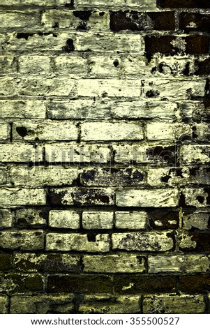 Urban grunge: Detail of whitewashed exterior brick wall, with filtered effects, for texture and background (sixth in a series of eleven) - stock photo