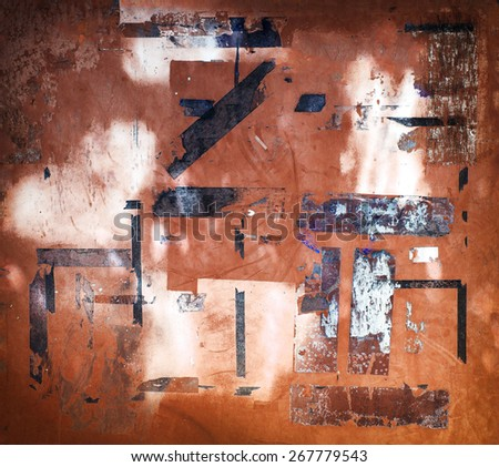 Urban grunge wall. Reminisce of old wall postings, and posting tape residue. - stock photo