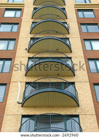 Urban housing. Balconies of a newly constructed highrise apartment building. - stock photo