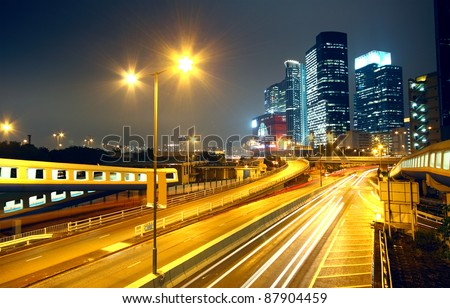 urban landscape at night and through the city traffic - stock photo