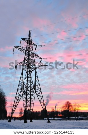 Urban landscape with electric line on sunset - stock photo