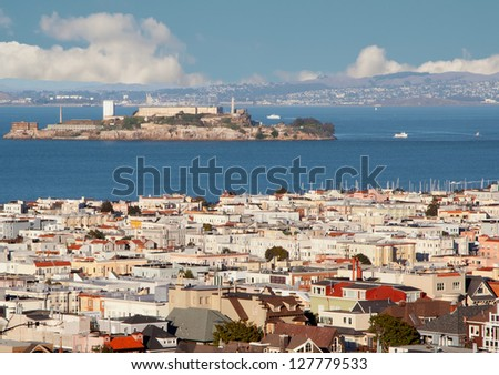 Urban landscape with San Francisco roofs, blue water and Alcatraz island. - stock photo