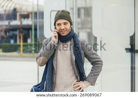 urban man in the city using smartphone - stock photo
