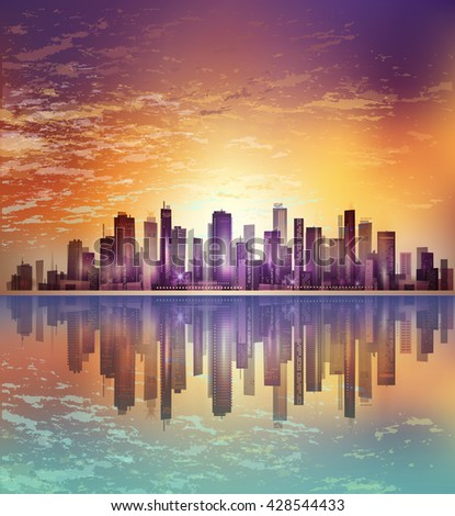 Urban night city landscape in moonlight or sunset, with reflection in water and cloudy sky - stock photo