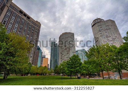 Urban park with the city skyline on the background 1 - stock photo