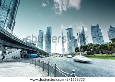 urban road and modern city skyline  - stock photo