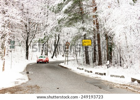 Urban Road at the City Limit of Berlin in Winter Covered with Snow - stock photo