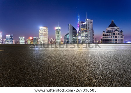 urban road,illuminated skyline background - stock photo