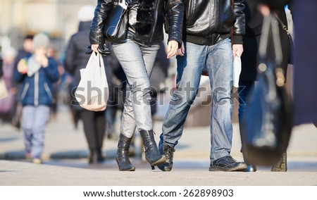 Urban rush hour. Pedestrians crossing a street in a city - stock photo