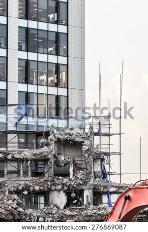 Urban scene. Dismantling of a house. Ruins of building under destruction in city center.  Industry. - stock photo