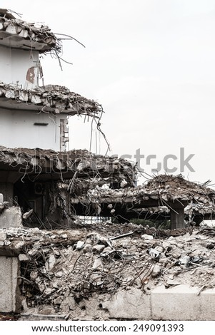 Urban scene. Dismantling of a house. Ruins of building under destruction. Industry. - stock photo