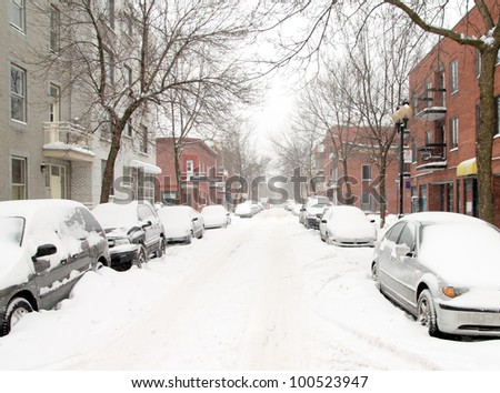 urban street in a snow storm - stock photo