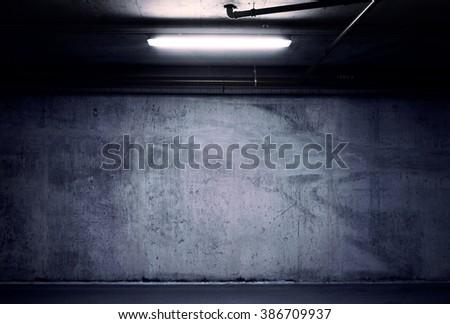 Urban underground background. Concrete wall under the lamp light in the dark. - stock photo