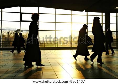 urban woman walking in a futuristic tunnel - stock photo