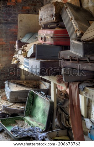 Urbex - empty, old and dirty suitcases, in light HDR processing - stock photo