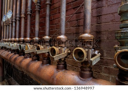 Urbex - Hydraulic valves used in a steel furnace, in HDR light processing - stock photo