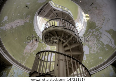 Urbex - Spiral stairway in an abandoned building, in light HDR processing. - stock photo