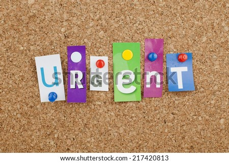 Urgent Cut out Letters - stock photo