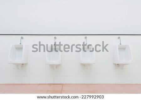 Urinals - stock photo