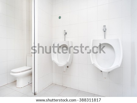 Urinals in the public toilet  - stock photo