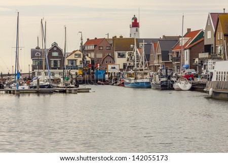 Urk town - Netherlands. View on small port in background lighthouse. - stock photo