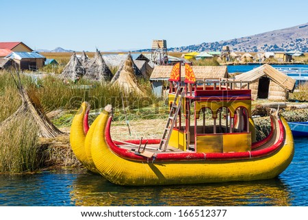 Uros floating islands in the peruvian Andes at Puno Peru - stock photo