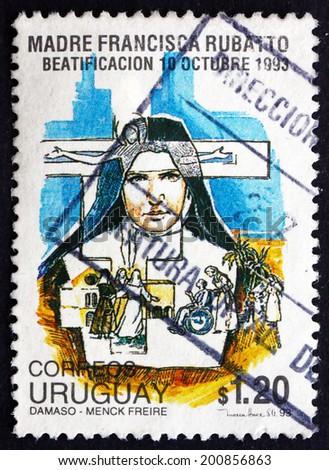 URUGUAY - CIRCA 1993: a stamp printed in the Uruguay shows Beatification of Mother Francesca Maria Rubatto, Italian Roman Catholic Nun, circa 1993 - stock photo