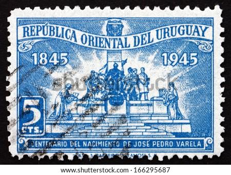 URUGUAY - CIRCA 1945: a stamp printed in the Uruguay shows Monument to Jose Pedro Varela, Author, circa 1945 - stock photo