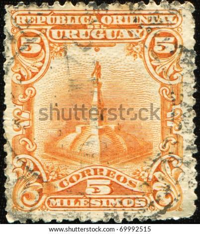 URUGUAY - CIRCA 1900: A stamp printed in Ururguay shows general Jose Gervasio Artigas monument, circa 1900 - stock photo