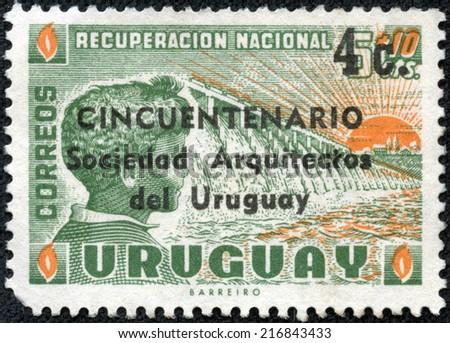 URUGUAY - CIRCA 1959: stamp printed by Uruguay, shows Dam, Child and Rising Sun, circa 1959 - stock photo