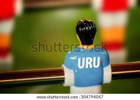 Uruguay National Jersey on Vintage Foosball, Table Soccer or Football Kicker Game, Selective Focus, Retro Tone Effect - stock photo