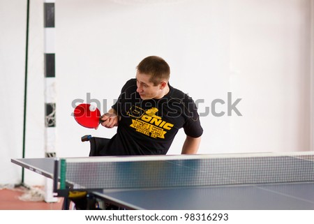 URYUPINSK- RUSSIA - MARCH 17: athlete sport young table tennis, ping-pong,  disabled athlete, Alexander Gorsky, 14 Open Championship of memory Uryupinsk NS Demidenko, Uryupinsk-Russia, March 17 2012. - stock photo