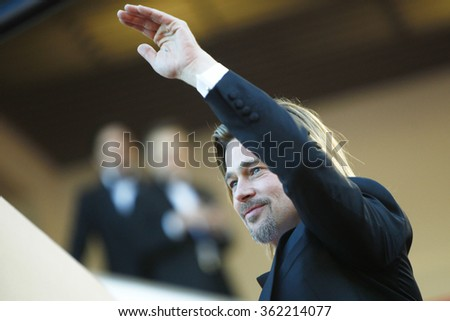 US actor Brad Pitt waves to the crowd as he arrives for the screening of 'Killing them Softly' presented in competition at the 65th Cannes film festival on May 22, 2012 in Cannes. - stock photo