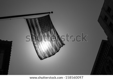 US american symbol flag over Black and white city urban shapes - stock photo
