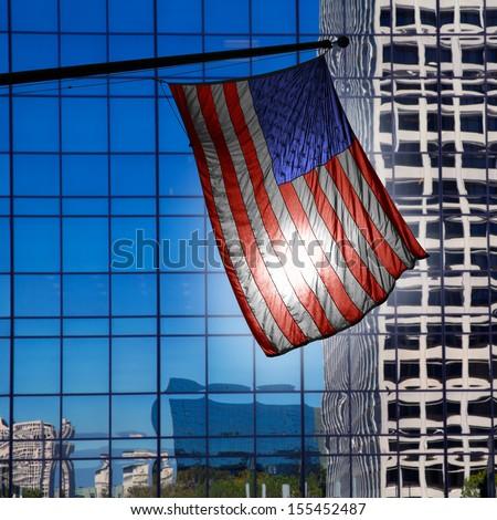 US american symbol flag over blue modern LA city buildings - stock photo